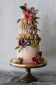 wedding cake designers white cake with macaron tower decorated with flowers winifred kriste cake