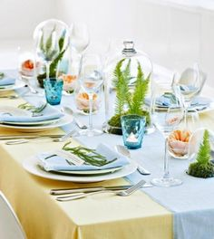 Keep your spring gathering light and airy with linen table coverings and clear glass containers.
