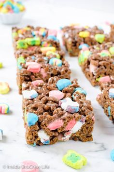 Lucky Charms Marshmallow Treats - these easy no bake cereal bars are loaded with magically delicious marshmallows! Make this easy recipe for parties and after school snacks! ~ Inside BruCrew Life