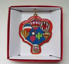 Decorate your tree with this colorful Brass Christmas Ornament Albuquerque New Mexico Hot Air Balloons Souvenir Gift.  Collect all the States of your favorite places.