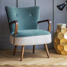 Sit back and relax in the ergonomic comfort of our Calvin chair in blue velvet and natural linen. This mid-century style design is the ultimate occasional chair, perfect for a cosy reading corner in the living area or bedroom.