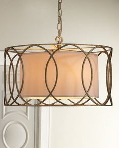 """Sausalito"" Five-Light Chandelier A cage of overlapping circles around a linen shade give this chandelier depth and visual impact. Made of wrought iron. Metal is hand worked ..."