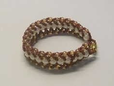 Flat spiral bracelet of seed beads and round beads. Free detailed tutorial.