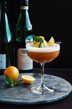 Fernet Champagne Flip: Champagne, Fernet-Branca, Ginger Liqueur, Egg White, Meyer Lemon Juice, Angostura Bitters, Lemon and Mint.