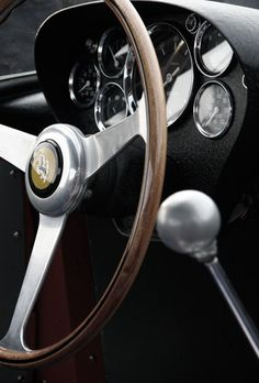 Vintage Ferrari interior. The old-style gated shifters are awesome.