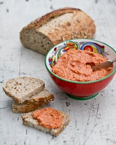 Tomato Almond Spread  3/4 cup almonds  ~14 ounces crushed tomatoes (San Marzano preferable, if you can find them!)  1 clove garlic  1 tablespoon paprika  1 tablespoon balsamic vinegar  2 teaspoons lemon juice  1/2 teaspoon salt  1/2 teaspoon red pepper flakes  1/4 cup olive oil