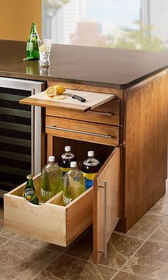 What a great concept for a wet bar!  Custom cabinetry allows so much flexibility when designing a space.  This integrated cutting board is perfect for slicing garnishes for your guests.  The bottom pull-out drawer for sodas and mixers is a great way to declutter the wet bar counters!  Add an undercounter fridge or wine cellar and you're ready to party!