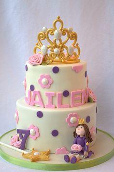 Princess birthday cake with sugar tiara, princess, and wand