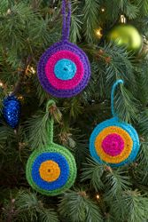 Bull's-Eye Ornaments | FaveCrafts.com...These are so colorful and pretty ;they'll make your tree really stand out!! Free pattern!
