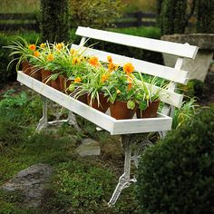 Give an old, worn bench new life as a planter. Here, a simple shelf built over the seat is a perfect place for a collection of container plants.