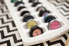 24 Brilliant Ways to Store Your Beauty Products- Create Your Own Eye Shadow Palette- Stick your eyeshadow singles into ice tray slots so you can see all the shades at once. Get more beauty tricks and organizing tips at redbookmag.com.