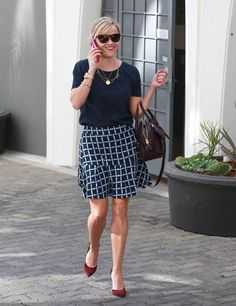 'Wild' actress Reese Witherspoon is all smiles while leaving her office in Beverly Hills, California on October 23, 2014.