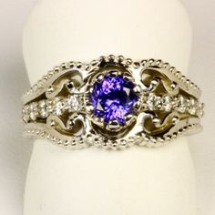 I have a tanzanite necklace, earrings and ring but nothing like this ring!  I love it and it is becoming more rare! Tanzanite Ring Designed By Christopher Michael .85 Carat BVV Color