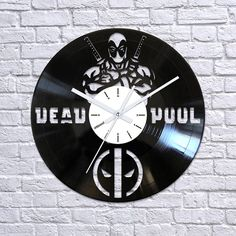 Deadpool vinyl clockDeadpool mask vinyl record by Artzavodstudio