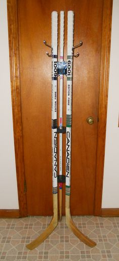 Hockey stick coat rack