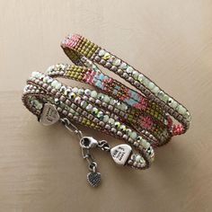 "BRILLIANCE WOVEN WRAP BRACELET -- Iridescent beads lend flashes of brilliance to this Adonnah Langer hand-woven wrap bracelet, with Czech and Japanese seed beads plus brass beads. Sterling silver end caps, lobster clasp and extender chain. Exclusive. Made in USA. 25-1/2"" to 26-1/4""L."