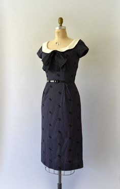 Vintage 1950s dress, black pin-striped cotton body with embroidered flowers, deep scoop neck with an ivory linen peter-pan collar and removable black organdy bow, short sleeve, fitted wiggle design, hidden back metal zipper.  - - - M E A S U R E M E N T S - - -  Fit/Size: M  Bust: 36 Waist: 28 Hips: 40 Length: 45  Maker/Brand: Jerry Gilden Condition: Great  - - - - - - - - - - - - - - - - - - - - - - - - - - Instagram: sweetbeefinds Facebook: sweet bee finds vintage