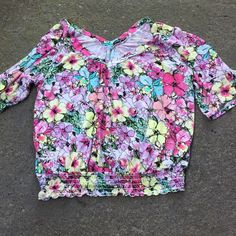 Cute T Shirt with floral print In lightly used condition with elastic around the waist Tops