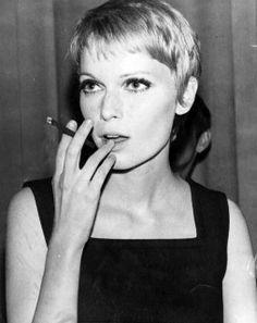Vintage 60s dressing-Portrait of Mia Farrow smoking, 1967
