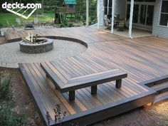 Oh. I like the multi color decking benches and fire pit. neat idea