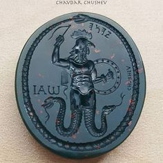 """A heliotrope intaglio by Chavdar Chushev. Based on ancient Roman """"magical gems"""" depicting Abraxas who was supposed to bring good luck and success in all ventures. . #ouroboros #intaglio #gem #intagliogem #bloodstone #heliotrope #jasper #hematite #gemcarving #seal #sigillo #cameo #ring #lapidary #jewelry #jewellery #showmeyourrings  #glyptic #antiquering #antiquejewelry #ancientjewelry #handcrafted #глиптика #talisman #abrasax #abraxas #magicgems #charm #amulet #magicjewelry"""