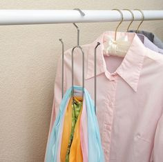DIY scarf hanger. Use a metal hanger and bend.