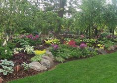 www.rocklandscapeinc.com. Rock Landscape & Gardens, Wi. Open by appointment. 1,000's of hosta varieties. Unique shrubs, ornamental trees and rare conifers. Family business. Find us on Facebook. shade-garden-gardens-landscaping-rock-garden-wisconsin-stone-landscape-design-hosta-astible-rock-36599.jpg
