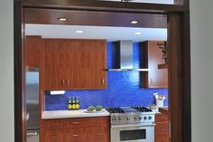 Cool, contemporary kitchen design with sleek cabinets and a bright blue tile wall. From 1 of 7 projects by Four Square Design Studio. Contemporary Kitchen Cabinets, Contemporary Kitchen Design, Contemporary Style, Warm Kitchen Colors, Blue Tiles, Kitchen Cabinet Design, Home Projects, Interior Design, Studio
