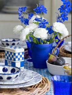 Rustic French Country table setting from Cote Sud home decor magazine from France.A hallmark of French Country Look is a painted and distressed furniture, and walls that have a crumbling old plaster feel. Fabric choices would be Toile, stripes and casual floral's.