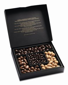 A gourmet chocolate box of assorted nibbles by Valrhona. Dark chocolate enrobed candied orange peel, milk, dark and dulcey chocolate enrobed hazelnuts & almonds. Types Of Chocolate, Chocolate Gifts, Love Chocolate, Chocolate Lovers, Chocolate Recipes, Almond Chocolate, Fruit Packaging, Packaging Design, Label Design