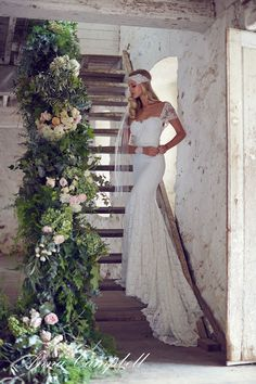 lace wedding dress with cap sleeves teamed with a sparkly bridal headband and cuff