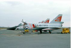 USAF Convair F-106A Delta Darts on the airfield at an AFB.