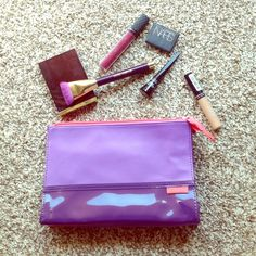 """Purple lilac coral makeup cosmetic travel bag NEW This brand new, never used Shiseido cosmetic bag is perfect for holding all your makeup essentials while traveling or going from home to work. The colorblock style in purple and lilac with the coral zipper, bottom, and interior makes it the perfect pop to inject brightness into your bag! Approx. measurements: 9.5"""" x 6.5"""" x 2.75"""" Condition: brand new, never used Shiseido Accessories"""