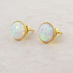 Discover these delicate white opal stud earrings from the Misskukie jewellery collection.This versatile piece of jewellery is the perfect accessory as it transitions from day to night jewellery easily. The size and sheer elegance make these white opal ear studs a decadent wedding accessory for brides and bridesmaids alike. Why not gift your friend or family member with these beautiful earrings, Opal is the October birthstone.  The ear studs are gold plated over sterling silver with an…