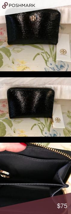 Authentic Tory Burch Robinson zip coin case Brand new compact zip case from Tory! Black patent leather, zip around closure, interior divided compartment, wall pockets and an attached key ring. Tory's signature logo on the front. Perfect for days you don't want to carry a large wallet - just add a credit card, some cash, attach your keys and go! Tory Burch Accessories Key & Card Holders