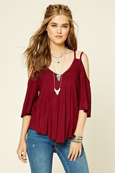 A knit open-shoulder top with a V-neckline, twin cami straps, a strappy back…