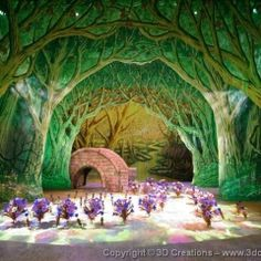 this stage scenery. Rolled cardboard and paper trees could recreate something like this.and then some pine trees, snow on the bridge and lots of ribbons, lanterns and poinsettias could turn it into a Christmas setting: