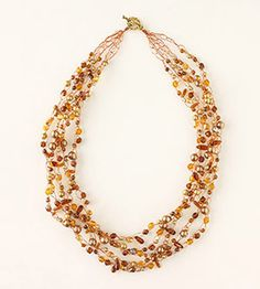 Crocheted Wire Necklace  This five-strand necklace employs a simple chain stitch to attach beads on 26-gauge copper wire. Faceted, iced, pyramid, teardrop, and glass beads in an array of gold, copper, and amber tones will encircle your neck in glowing color.  Get instructions for Crocheted Wire Necklace.