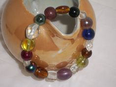 Handmade BRACELET Made with Colorful Glass Beads in Earthtone and Clear Colors. $9.00, via Etsy.