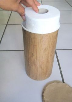 Who knew an oatmeal container keeps 2 rolls of toilet paper clean  easy to transport! The heck with decorating the outside...this is great for camping.