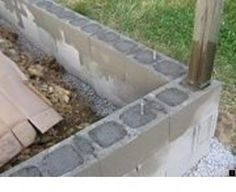 How to Build a Mortarless Concrete Stem Wall. A concrete stem wall can be built out of block, rod, and concrete, without the use of any mortar. Build a Shed on an Inexperienced Weekend Ryan Shed Plans Shed Plans and Designs For Easy Shed Building! Concrete Block Walls, Cinder Block Walls, Concrete Wall, Concrete Block Retaining Wall, Cinder Blocks, Retaining Walls, Concrete Patio, Greenhouse Plans, Outdoor