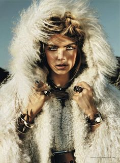 Just like everything, from the eye liner to the big chunky bracelet. No need to comment that lovely Mongolian Lamb fur.