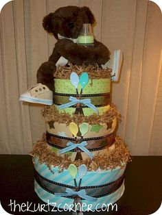 Diaper cake- boy style- love the spoons in bows on the front!