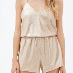 Sequin rose gold romper/jumpsuit - BRAND NEW Adorable sequin rose gold romper by Forever 21 Special Collection. This is brand new with tags, I just never had the chance to wear it! Grab your fav pair of stilettos or ankle booties, dress it up with some earrings and a long necklace and you are date night ready. Forever 21 Other