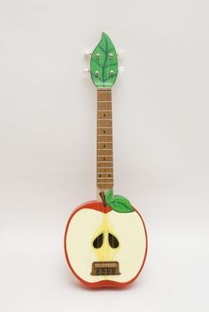 Because I need to have a Ukulele (Applelele--haha!) that looks like an adorable apple!  Made by Celentano Woodworks, based in Asheville, NC and sold on Etsy for $395.00.  He does custom orders, too.