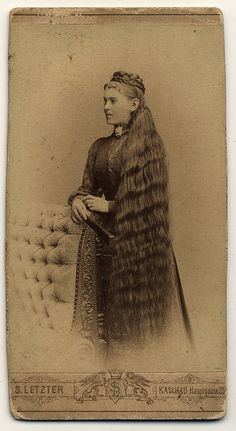 Young woman with long hair and braided hairpiece, Austro-Hungarian, ca. 1870s-1880s.