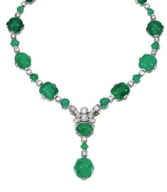 EMERALD AND DIAMOND NECKLACE, 1930S.  Designed as a suite of cabochon emeralds alternating with baguette diamonds, the front embellished with a geometric motif set with circular-, single-cut and baguette stones, mounted in platinum, French assay and maker's marks, necklace length approximately 410mm, the front part detaches, to be worn as a brooch, the necklace detaches, to be worn as two bracelets each measuring approximately 185mm.