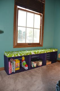 A bench made from Michael's crates plus a homemade cushion. Fab!/Not crazy about the colors but super cute idea!!!