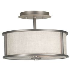 Two-light semi-flush mount in silver and white with a drum shade.    Product: Semi-flush mountColor: Silver and white...