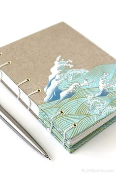 Handmade Journal with Waves cut out of Japanese Paper – great gift for a writer – Ruth Bleakley Handmade Journal with Waves cut out of Japanese Paper – great gift for a writer Handmade Journal with Waves papercut by Ruth Bleakley Handmade Notebook, Diy Notebook, Notebook Design, Handmade Journals, Handmade Books, Journal Covers, Book Journal, Art Journals, Sketchbook Cover